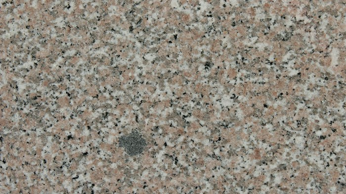 Crema Rosita is a traditional, polished granite with heavy graining and consistent patterning of milky white, black and blushing beige particles.